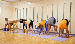 """Uttanasana (standing forward bend) practiced with and without support."""